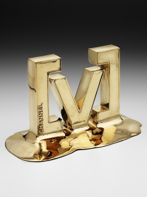 Channel V-Oz Artist Award. Custom metal, gold finish H: 200mm W: 220mm.