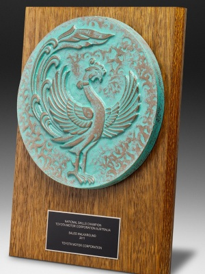 Toyota-National Skills Champion Award. Custom timber plaque with mounted plate and mounted logo. H: 290mm W: 210mm.