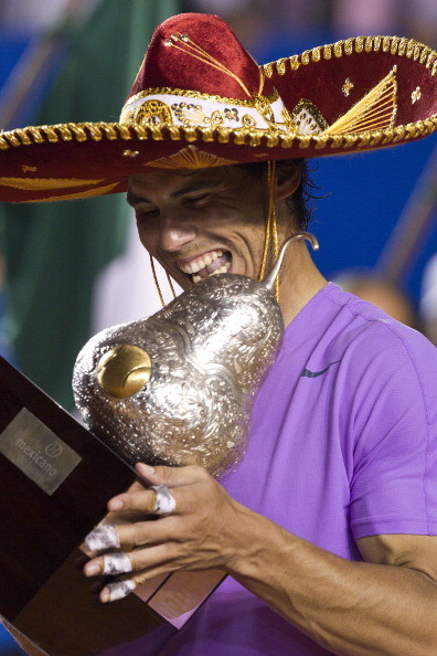 ACAPULCO, MEXICO - MARCH 02: Rafael Nadal looks on his trophy after winning the final round match against David Ferrer at the ATP Mexican Open Telcel on March 2, 2013 in Acapulco, Mexico. (Photo by Misael Montano/LatinContent/Getty Images)