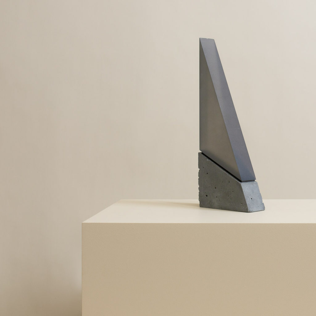 Large Spire with smoky acrylic and dark polished concrete