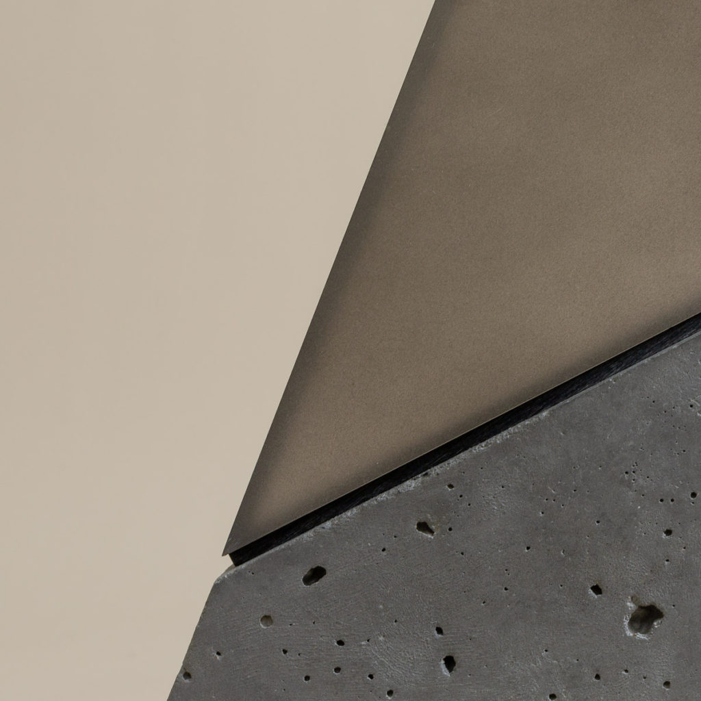 Spire detail with smoky acrylic and dark polished concrete