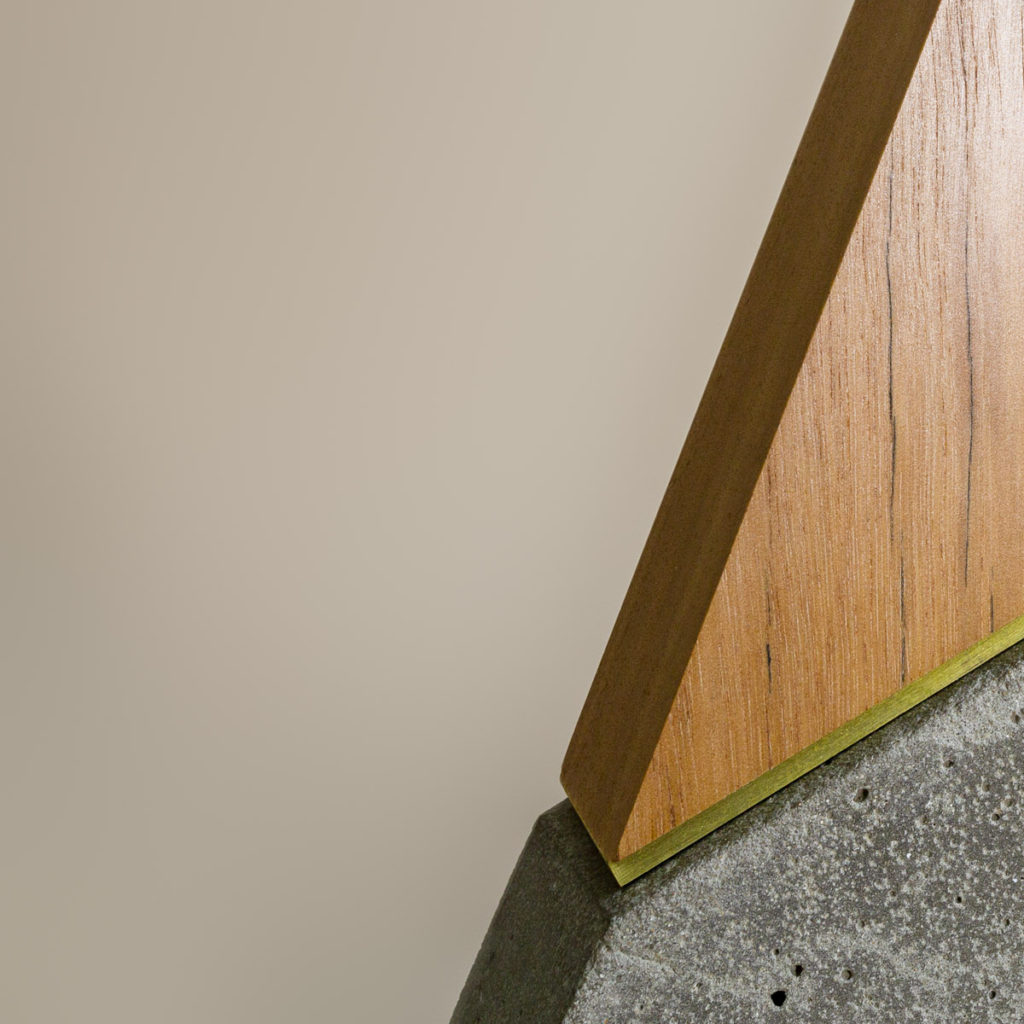 Spire brass spacer detail with highly polished concrete