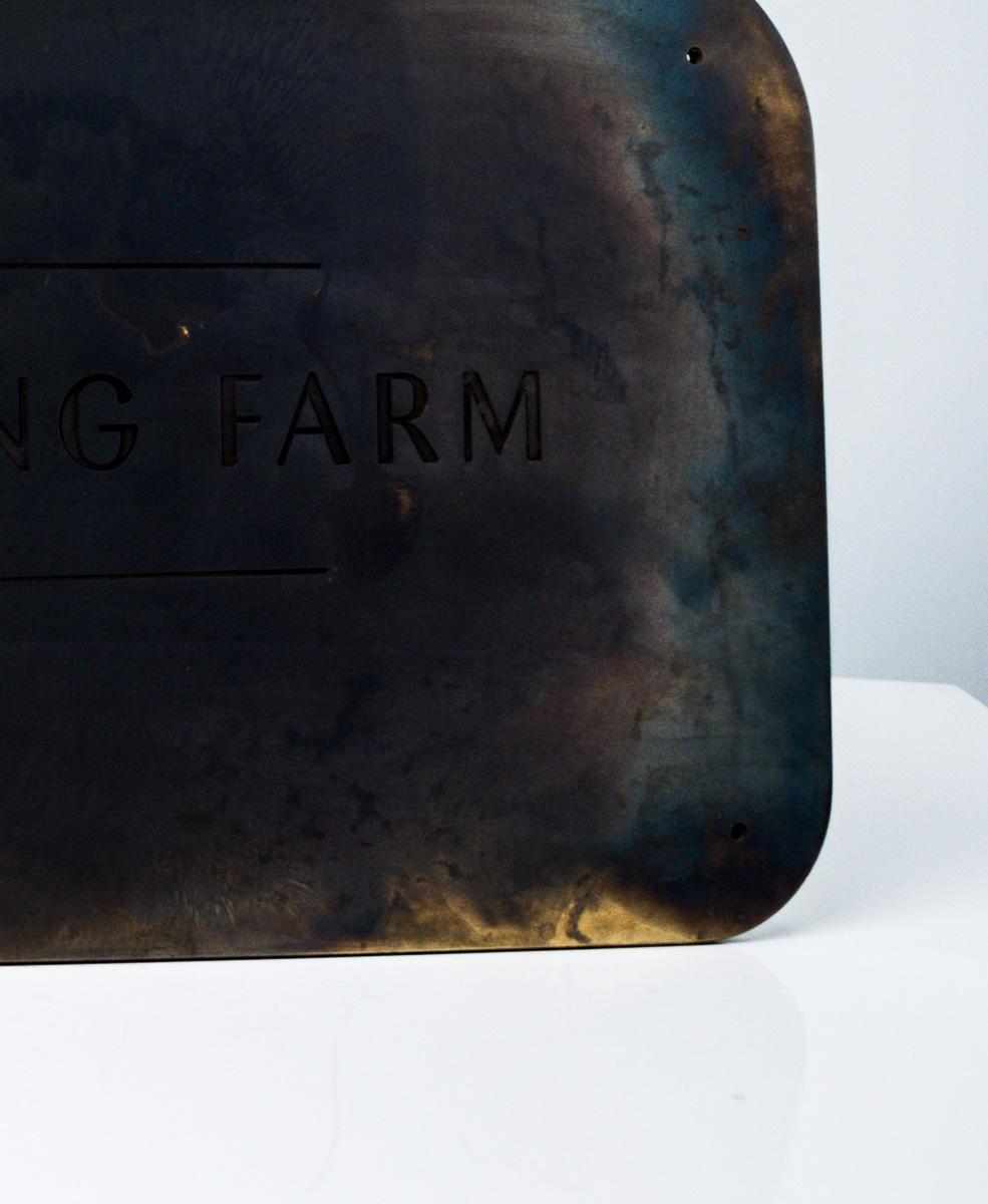 Bushfurlong Farm Patinated Brass Entry Signage Detail